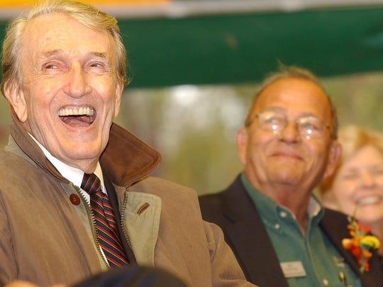 Former Arkansas Governor Dale Bumpers, left, laughs during the dedication ceremony for the James A Gaston Visitor Center in Bull Shoals on Oct. 19, 2006. Gaston, right, and Bumpers were lifelong friends.