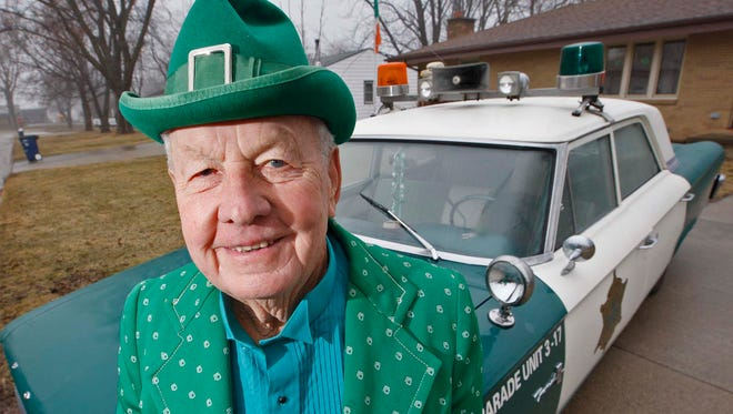 Leo Ward, in his green outfit and green and white police cruiser, waiting to represent Melrose in the upcoming St. Patrick's Day Parade, on the south side of Des Moines, Tuesday, March 10, 2009.