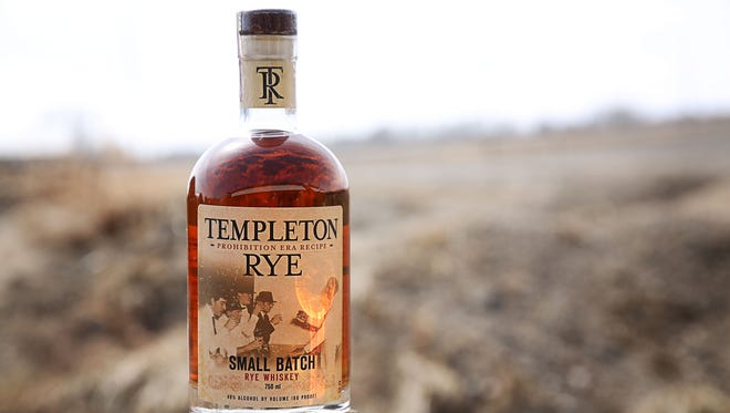 Scott Bush and Keith Kerkhoff of Templeton Rye with the pigs of the Templeton Rye Pork Project.
