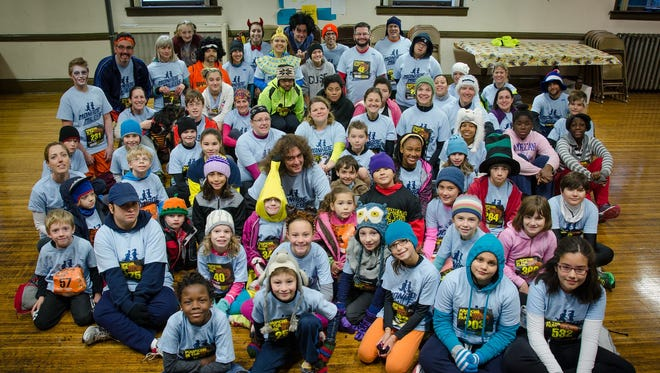 Members of the Monroe Milers kids' running group gather for a photo.