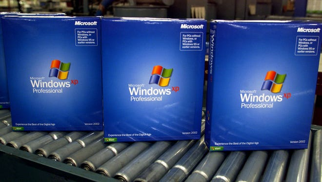 Copies of Microsoft's Windows XP Pro roll off the packaging line Oct. 25, 2001, in Greeley, Colo.