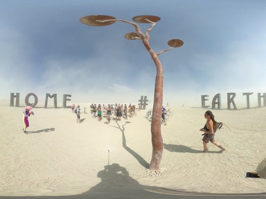 "Jeff Schomberg and Laura Kimpton's pieces, ""Earth,"" ""Home,"" ""@' and ""#"" at Burning Man 2016."