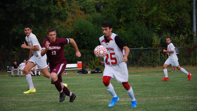 Millbury High School's Connor Winston, wearing sports jersey No. 13, is co-captain of the Millbury High varsity soccer team.