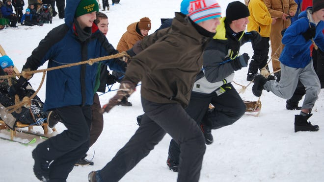 Alexandria Boy Scouts Troop 112 was the host for the 2015 Klondike Derby, attracting 292 scouts and adult leaders to the annual two-night camp out and leadership and skills competition at the Teetertown Preserve in Port Murray, Jan. 23-25. The scouts woke up to six inches of snow on Jan. 24, ideal for a winter scouting event, held nationally since 1949. Event organizer Tom Callahan and the youth and adult leadership of Troop 112, sponsored by the Alexandria First Presbyterian Church, set up a schedule of eight stations, including animal track and fur identification; knots and pioneering skills; compass orienteering course; a first aid station where scouts dealt with a simulated polar bear attack; fire building competition; ice rescue station; and a Lumber Jack station. The culmination of the Arctic challenge was a sled race, where the Scouts served as sled dogs, with the 18 troops from Hunterdon and Mercer counties competing on a figure-eight course. Here, Boy Scouts from Troop 112 in Alexandria and Troop 251 in Kingwood participate in the sled race. Annually, scouting districts throughout the U.S. and Canada host a Klondike Derby event, which is based on the Klondike Gold Rush, but varies by district. For more information on Troop 112 activities, visit www.bsa-troop112.net.