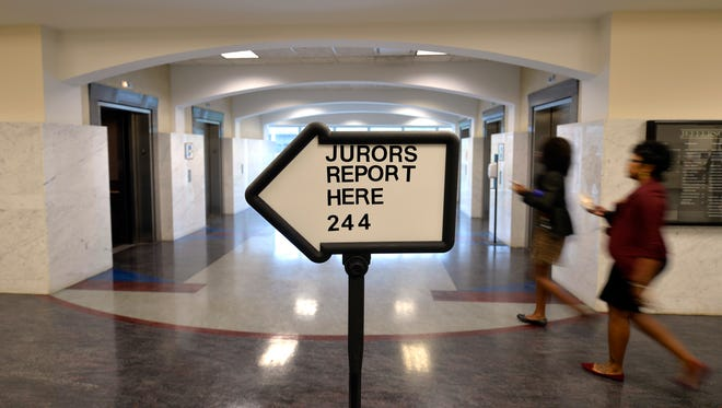 Potential jurors head to the jury room to check in at the Jefferson County Judicial Center.