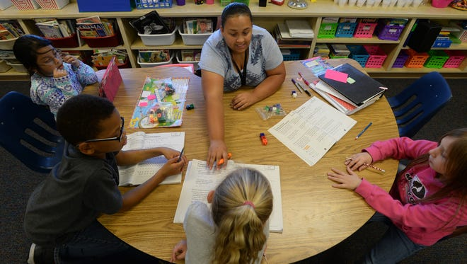 Courtney Washington teaches math to students at Fairview Elementary School in Richmond.