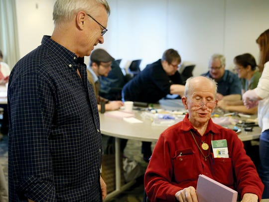 Workshop instructor Curt Johnson from the University of Washington, an assistive technology specialist, works with Charles O' Hara of Poulsbo .