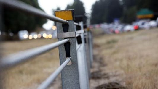 Cable barriers, like these along Interstate 5 in Wilsonville, help prevent out-of-control vehicles from crossing highway medians.