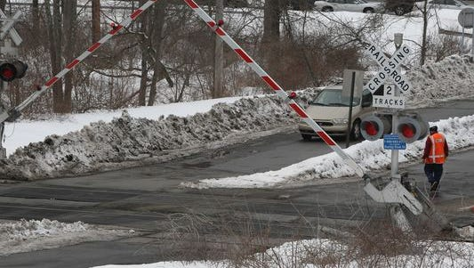 Metro-North Railroad workers tested crossing equipment at the Roaring Brook Road highway-rail grade crossing in Chappaqua earlier in March 2015. New Castle officials plan to add road signs and pavement markings to make the crossing safer for drivers.