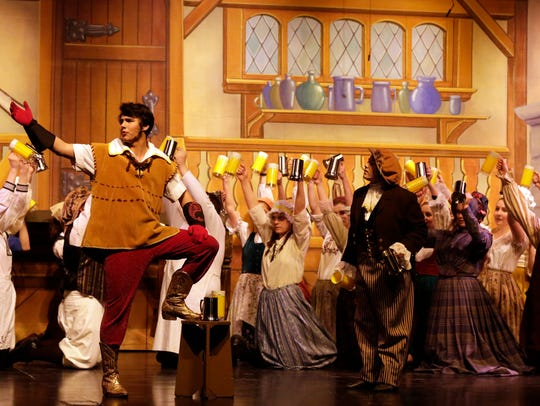 Christopher Rost as Gaston and the cast rehearse Oshkosh