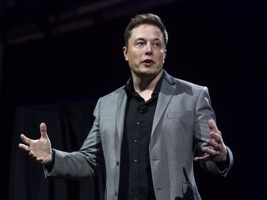 Elon Musk, CEO of Tesla Motors Inc., unveils the companyís newest products, Powerwall and Powerpack in Hawthorne, Calif., Thursday, April 30, 2015. (AP Photo/Ringo H.W. Chiu) ORG XMIT: NYOTK