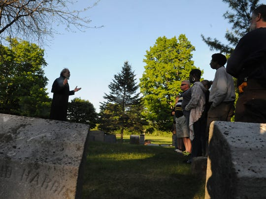 """Eerie stories are told at Bayview Cemetery during a past Door County Trolley """"Haunted Olde Sturgeon Bay"""" tour."""