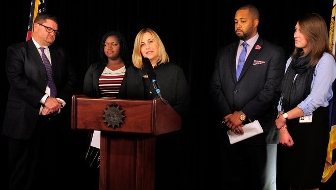 Mayor Megan Barry announces the creation of the Office of Economic Opportunity and Empowerment on Thursday. She appointed Erik Cole, left, to lead the new office, and he will be supported by, from left, Adriane Bond Harris, Ashford Hughes and Anne Havard.