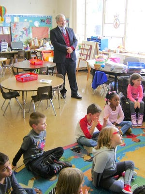 Paolo DeMaria watches as Spanish Immersion second-graders discuss the life of Martin Luther King Jr.
