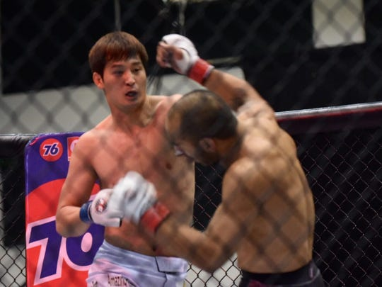 Han Seul Kim of South Korea defeats Frank Camacho of Saipan with a 1st round total knockout, referee stoppage at PXC 54 at the University of Guam Calvo Field House on Friday, July 8, 2016.