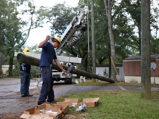 Crews of linemen from Columbus, Nebraska work to restore