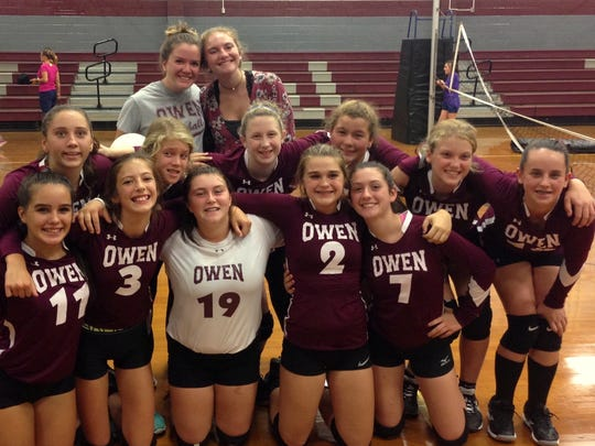 Emily Price, back row on right, stands behind the Owen Middle School volleyball team she coached with Ashley Henderson, left in back, this year.