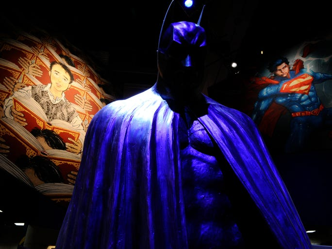 A statue of the Dark Knight stands in the middle of DC Entertainment's booth preview night at Comic-Con International: San Diego. DC is celebrating Batman's 75th anniversary with an extensive display at here.