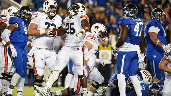 Peyton Barber (25) celebrates a touchdown.  Auburn