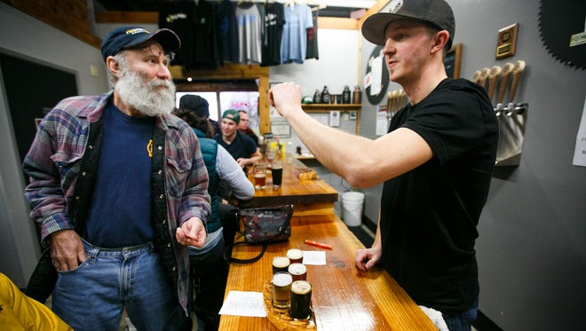 Chris Perry orders a tasting flight from Jake Bonham at Salem Ale Works for Zwickelmania on Saturday, Feb. 13, 2016. Now SAW is about to get bigger digs.