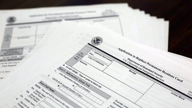 Some of the immigration forms the staff of Sylvia Chapa's helps clients with. The forms can be dozens of pages long and one wrong answer could have a person sent to deportation hearings.