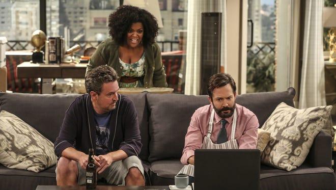 Matthew Perry as Oscar Madison, Yvette Nicole Brown as Dani, and homas Lennon as Felix Unger in CBS's 'The Odd Couple.'
