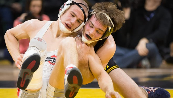 Iowa's Brandon Sorensen grapples with Ohio State's Micah Jordan in a 149-pound match at Carver Hawkeye Arena in Iowa City on Friday, January 27, 2017.
