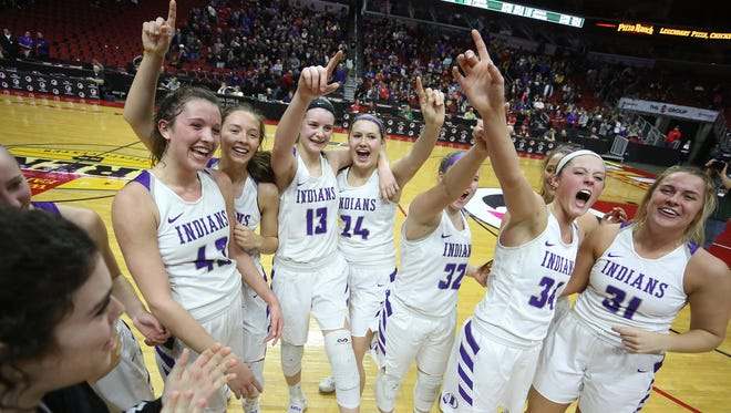The Indianola Indians celebrate their win over Johnston. Top-ranked Indianola beat No. 8 Johnston 77-67 in a Class 5A quarterfinal March 1 at Wells Fargo Arena in Des Moines.