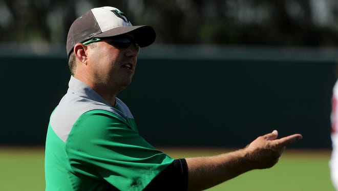 Iowa Park head baseball coach Michael Swenson talks to a batter in the game against Hirschi Tuesday, April 11, 2017, at Hoskins Field.