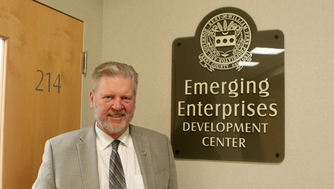 James Waddington, executive director of the Kent Economic Partnership Inc., stands in front of the new Kent County Emerging Enterprise Development Center in the Kent County Levy Court complex.