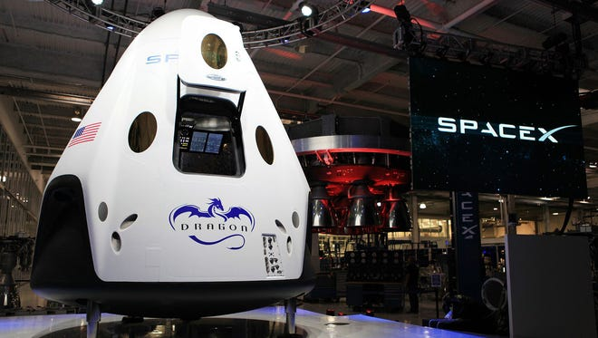 At its Hawthorne, Calif., headquarters in June 2014, SpaceX unveiled a mock-up of its Crew Dragon capsule designed to fly astronauts to and from the International Space Station. SpaceX recently leased an Air Force facility at Cape Canaveral where it will prepare the Dragon capsules.