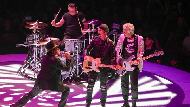 """Singer Bono, from left, drummer Larry Mullen, Jr., guitarist The Edge and bassist Adam Clayton, of the band U2, perform on stage during their """"eXPERIENCE + iNNOCENCE Tour"""" at Capitol One Arena on Sunday, June, 17, 2018, in Washington. (Photo by Brent N. Clarke/Invision/AP)"""