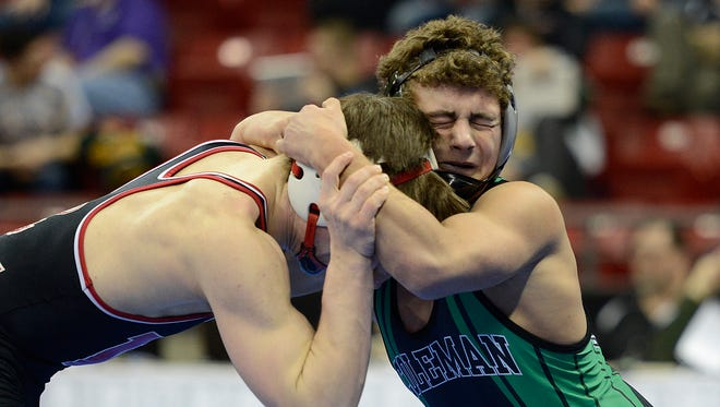 Kevin Lansin, right, battles Westby's Ross Withington at the individual state tournament last weekend. He posted a major decision at 152 pounds to help Coleman rally to victory at team sectionals.