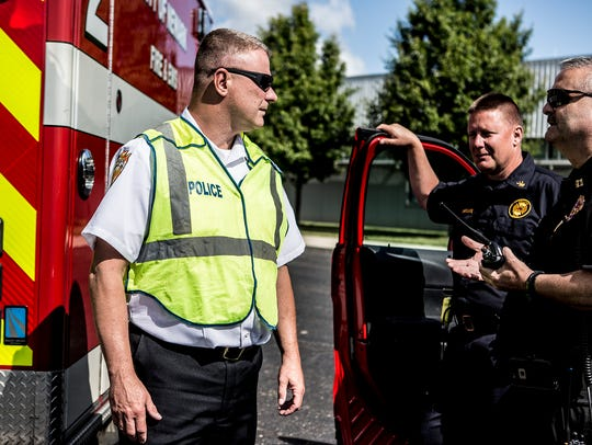 Police Chief Barry Connell talks with other officers at an active shooter simulation held previously in Newark. A training will be held Wednesday at Newark Catholic.