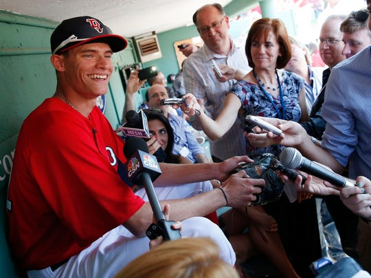Boston Red Sox first-round draft pick Trey Ball, left, speaks with reporters before a baseball game in 2013.
