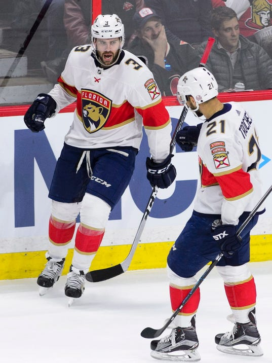 Florida Panthers defenseman Keith Yandle (3) celebrates a goal with centre Vincent Trocheck (21) against the Ottawa Senators during the first period of NHL hockey action in Ottawa on Tuesday, March 20, 2018. (Sean Kilpatrick/The Canadian Press via AP)