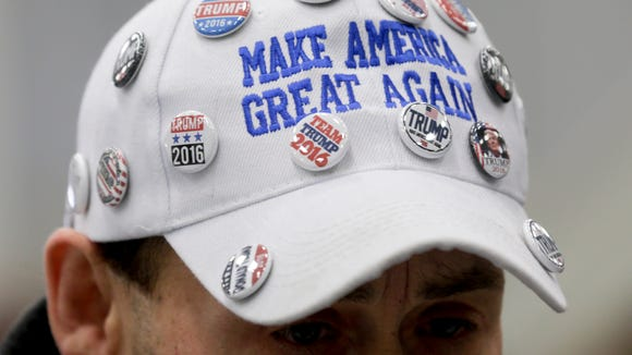 A supporter of Republican presidential candidate Donald Trump wears a hat with pins before a rally at Griffiss International Airport in Rome earlier in April.