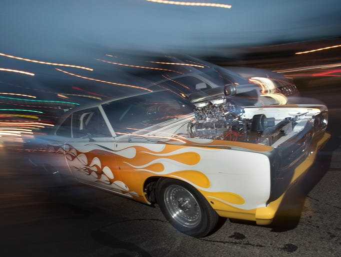 Night-time cruisers light up the road  at Woodward