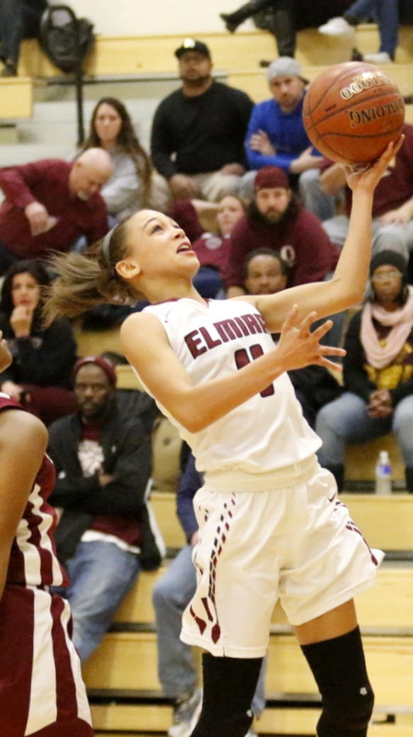 Elmira's Kiara Fisher goes in for a layup as Ossining's