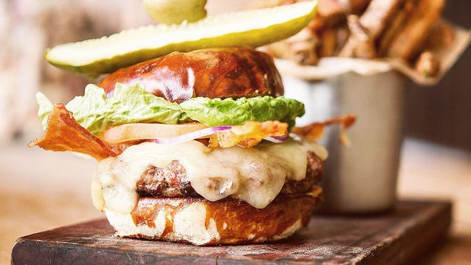 A burger prepared at Public in Zeeland. The restaurant announced early this month it will once again open for Monday burger night from 11 a.m. to 9 p.m. weekly.
