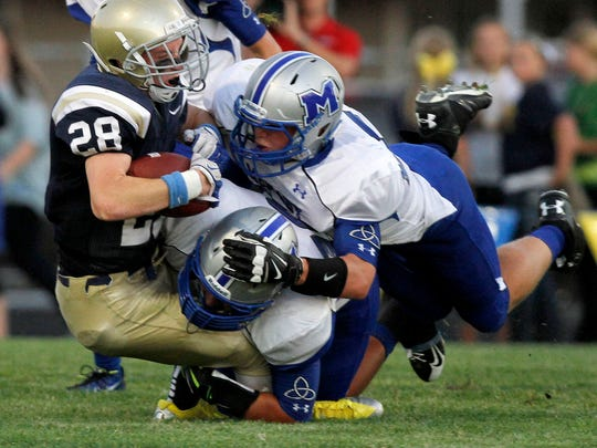 McNary's Connor Goff and Kolby Barker tackle West Albany's