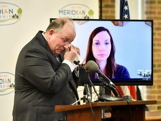 Meridian Township Manager Frank Walsh wipes a tear from his eye during a press conference Thursday, Feb. 1, 2018, where the township publicly apologized to Brianne Randall-Gay, a Nassar victim whose 2004 sexual assault claim in Meridian Township was not forwarded to prosecutors.  She joined the press conference via video link.