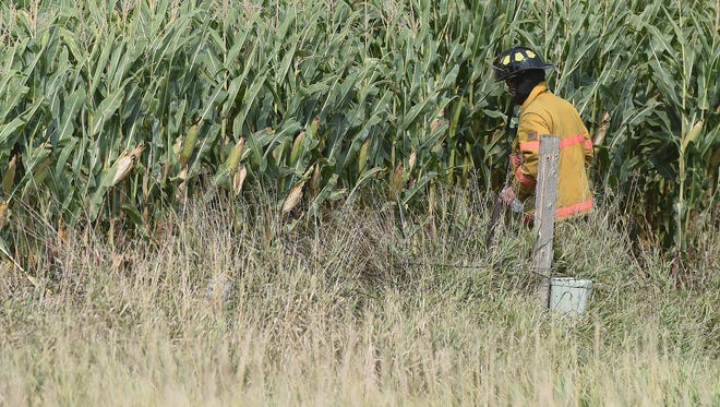 Emergency personnel respond to a plane crash in a corn field outside of Viborg on Friday, Sept. 2, 2016.