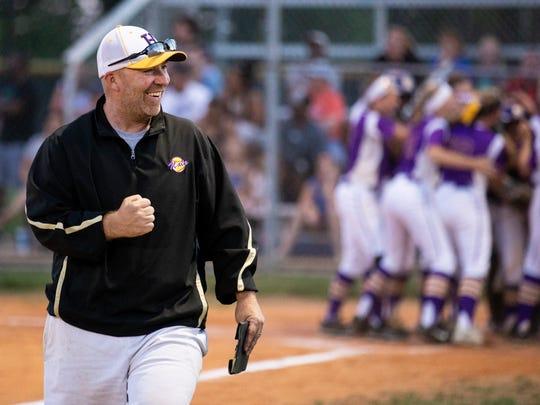 Male Coach Josh Bloomer celebrates Madison McCoy's