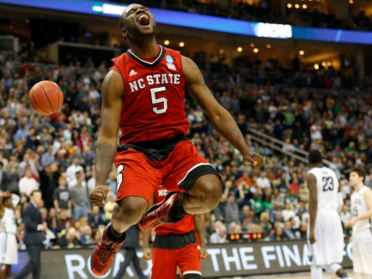 North Carolina State Wolfpack guard Desmond Lee (5) celebrates after defeating the Villanova Wildcats 71-68 in the third round of the 2015 NCAA Tournament at Consol Energy Center.