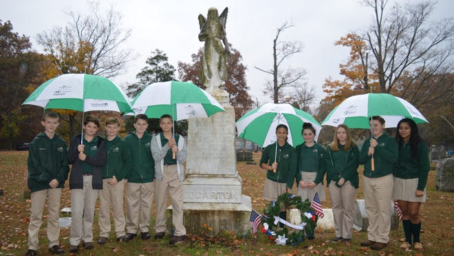 (From left) Nathan Adler, Jake Caselli, Parker Swift, Michael Hoban, Nicholas Volpe, Angelina Alimenti, Cameron Cafiso, Zoe Marino, Cole Graiff and Thalia Cruz, members of the Student Council at Edgarton Christian Academy in Newfield, observed Veterans Day by placing a wreath at the grave of Brevet Brigadier General Warren Edgarton.