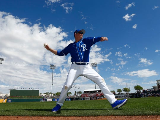 Actor Jim Caviezel warms up before throwing out the first pitch at a spring training baseball game between the Kansas City Royals and the Chicago Cubs on Wednesday, March 14, 2018, in Surprise, Ariz. The Royals defeated the Cubs 7-6. (AP Photo/Ross D. Franklin)