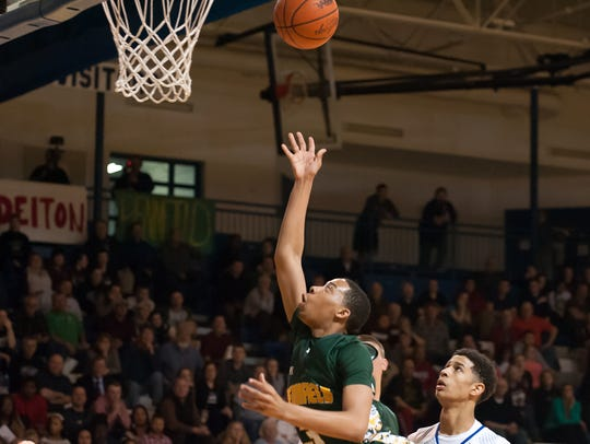 Pennfield's Ron Jamierson drives the basket against