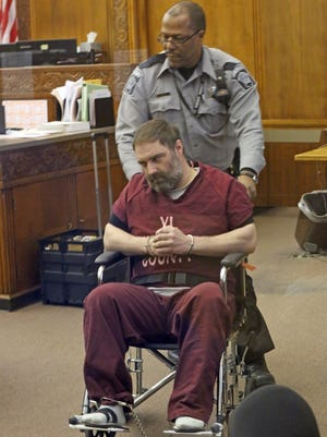 Dan Popp, who faces three counts of first-degree intentional homicide in the deaths of Jesus Manso-Perez, Phia Vue and Mai Vue,  appears in Milwaukee County court April 6.
