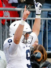 Penn State quarterback Trace McSorley celebrate his touchdown against Ohio State during the first half of an NCAA college football game Saturday, Oct. 28, 2017, in Columbus, Ohio. (AP Photo/Jay LaPrete)